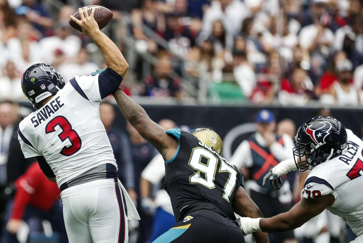 Houston Texans quarterback Tom Savage (3) loses the ball as he is hit by Jacksonville Jaguars defensive tackle Malik Jackson (97) during the second quarter of an NFL football game at NRG Stadium on Sunday, Sept. 10, 2017, in Houston. ( Brett Coomer / Houston Chronicle )