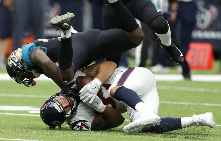 Houston Texans tight end C.J. Fiedorowicz (87) is tackled as he makes a reception against the Jacksonville Jaguars during the second quarter of an NFL football game at NRG Stadium on Sunday, Sept. 10, 2017, in Houston. ( Brett Coomer / Houston Chronicle )