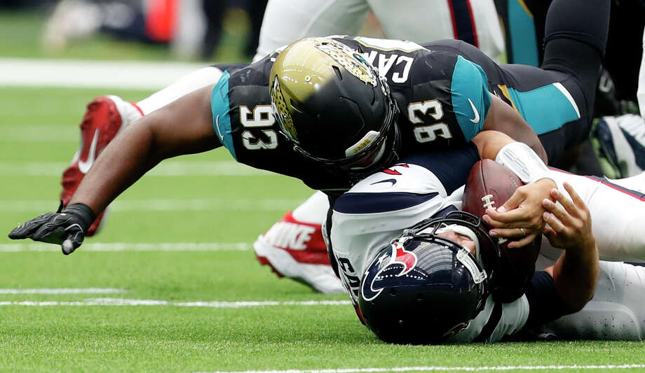 Houston Texans quarterback Tom Savage (3) is sacked by Jacksonville Jaguars defensive tackle Calais Campbell (93) during the second quarter of an NFL football game at NRG Stadium on Sunday, Sept. 10, 2017, in Houston. ( Brett Coomer / Houston Chronicle ) Photo: Brett Coomer/Houston Chronicle