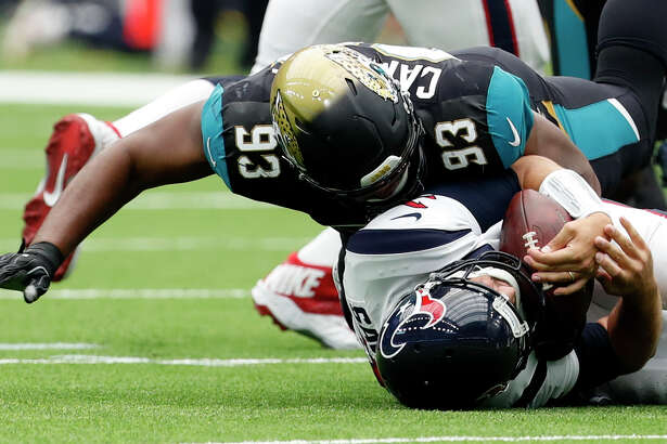 Houston Texans quarterback Tom Savage (3) is sacked by Jacksonville Jaguars defensive tackle Calais Campbell (93) during the second quarter of an NFL football game at NRG Stadium on Sunday, Sept. 10, 2017, in Houston. ( Brett Coomer / Houston Chronicle )