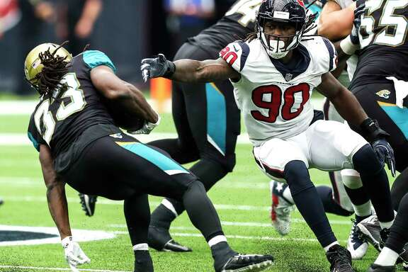 Jaguars running back Chris Ivory, left, avoids Texans defensive end Jadeveon Clowney, who managed just one tackle in the 29-7 loss Sunday at NRG Stadium.