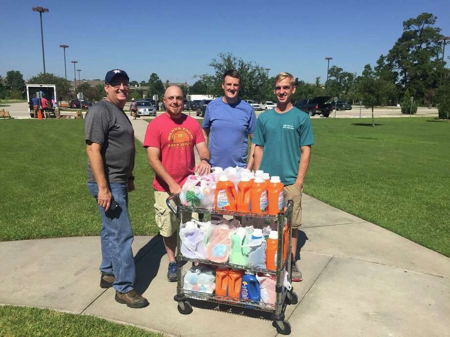 "From left to right: Grace Crossing Senior Minister Doug Peters, Youth Minister Kevin Hackett, Michael Amend and Brady Cox have been helping with a disaster relief effort at the church that includes a ""Hurricane Bucket Challenge"" to provided needed cleaning supplies to flood victims. Photo: Photo By Andrew DuBois"