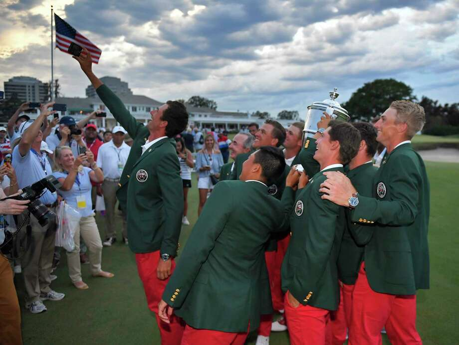 Members of the U.S. Walker Cup team pose for a selfie with the championship trophy after defeating Great Britain and Ireland in Los Angeles. Photo: Mark J. Terrill, STF / Copyright 2017 The Associated Press. All rights reserved.