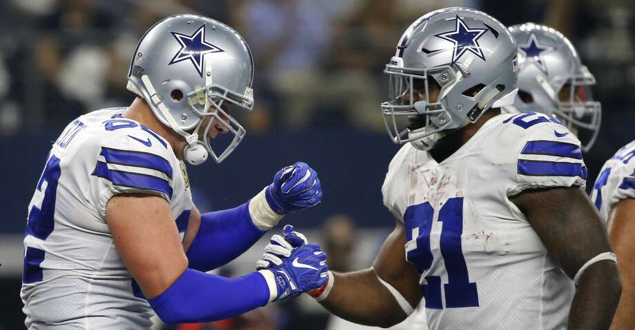 Dallas Cowboys' Jason Witten (82) and Ezekiel Elliott (21) celebrate a touchdown catch by Witten in the first half of an NFL football game against the New York Giants on Sunday, Sept. 10, 2017, in Arlington, Texas. (AP Photo/Ron Jenkins) Photo: Ron Jenkins/Associated Press