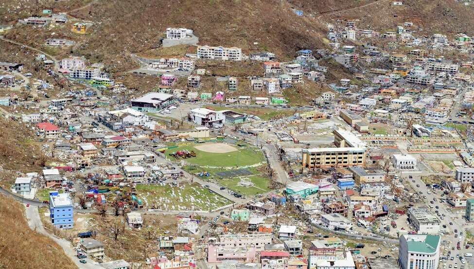 In this undated photo provided on Sunday Sept. 10, 2017, by the British Ministry of Defence, some of the damage to The British Virgin Isles, seen from the air. The wild isolation that made St. Barts, St. Martin, Anguilla and the Virgin Islands vacation paradises has turned them into cutoff, chaotic nightmares in the wake of Hurricane Irma, which left 22 people dead, mostly in the Leeward Islands. (MOD via AP) ORG XMIT: LON831
