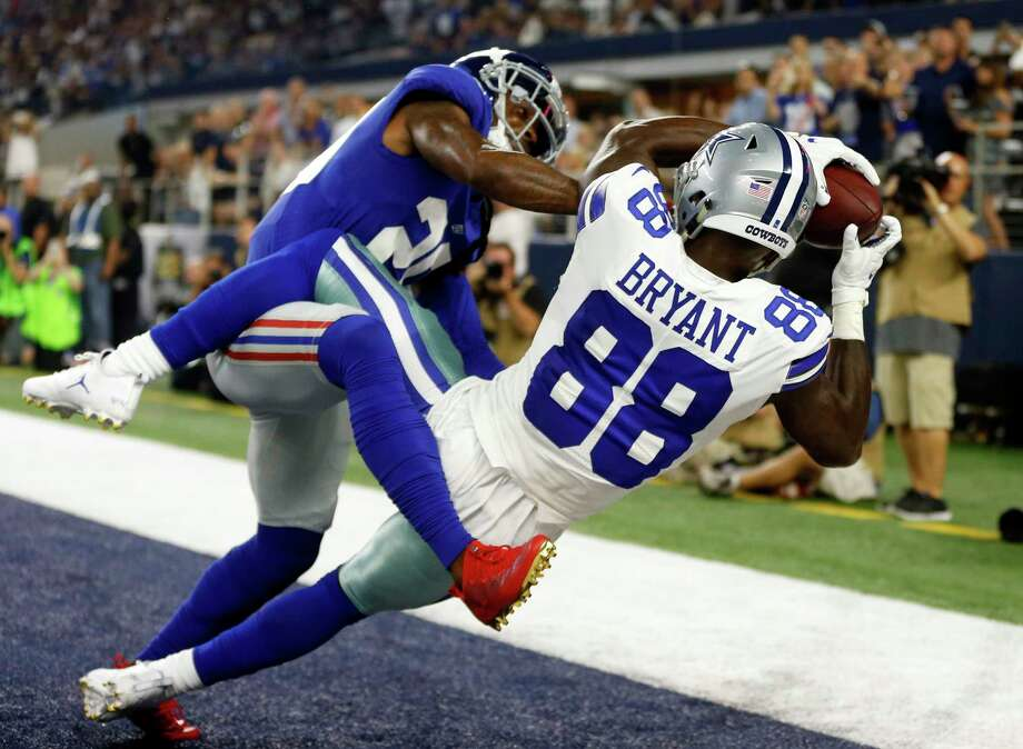 New York Giants cornerback Janoris Jenkins (20) breaks up a pass in the end zone intended for Dallas Cowboys wide receiver Dez Bryant (88) in the first half of an NFL football game, Sunday, Sept. 10, 2017, in Arlington, Texas. (AP Photo/Ron Jenkins) Photo: Ron Jenkins, FRE / FR171331 AP