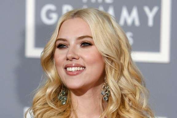 Scarlett Johansson arrives for the 49th Annual Grammy Awards on Sunday, Feb. 11, 2007, in Los Angeles. (AP Photo/Matt Sayles)