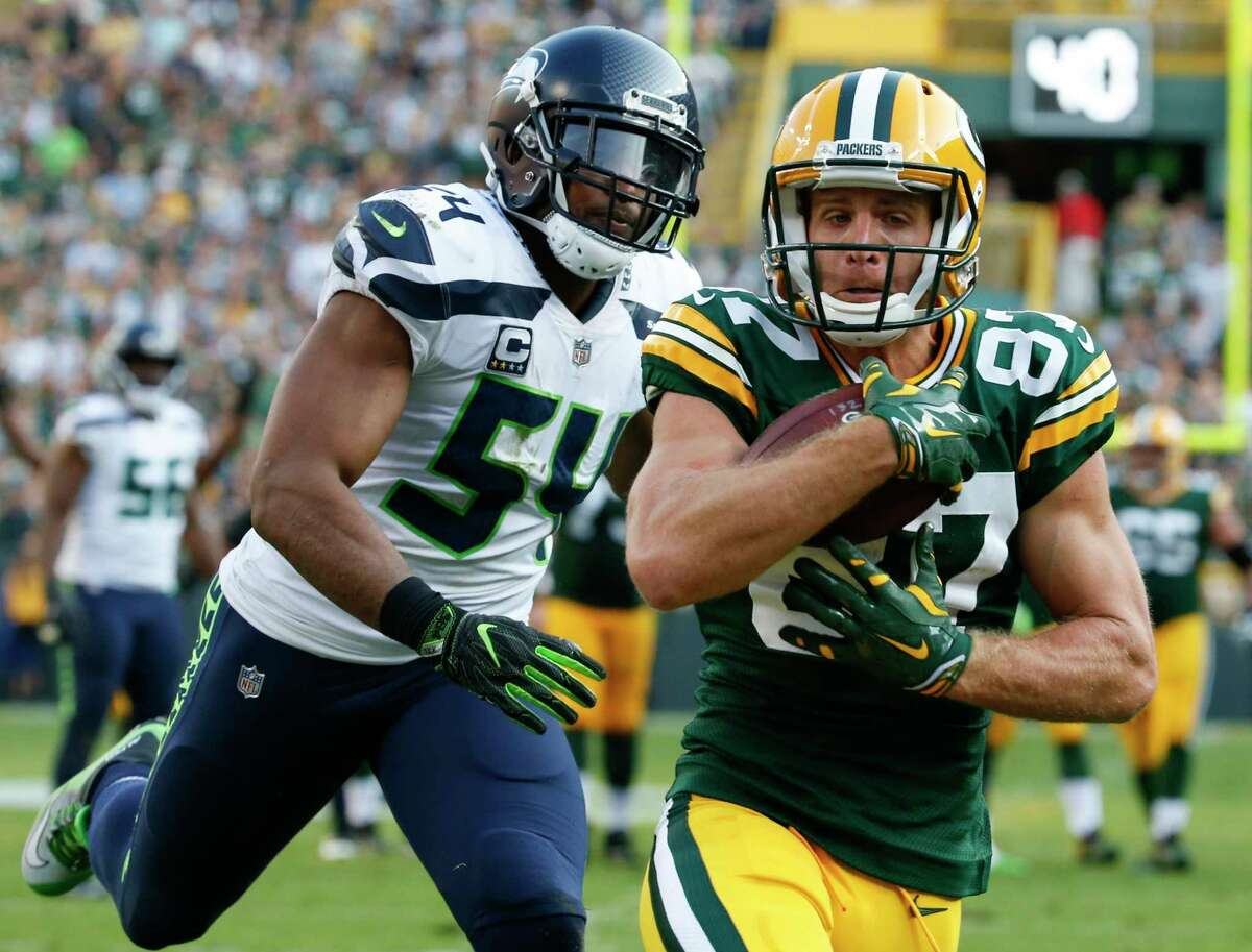 Green Bay Packers' Jordy Nelson catches a touchdown pass in front of Seattle Seahawks' Bobby Wagner during the second half of an NFL football game Sunday, Sept. 10, 2017, in Green Bay, Wis. (AP Photo/Mike Roemer) ORG XMIT: WIMG134
