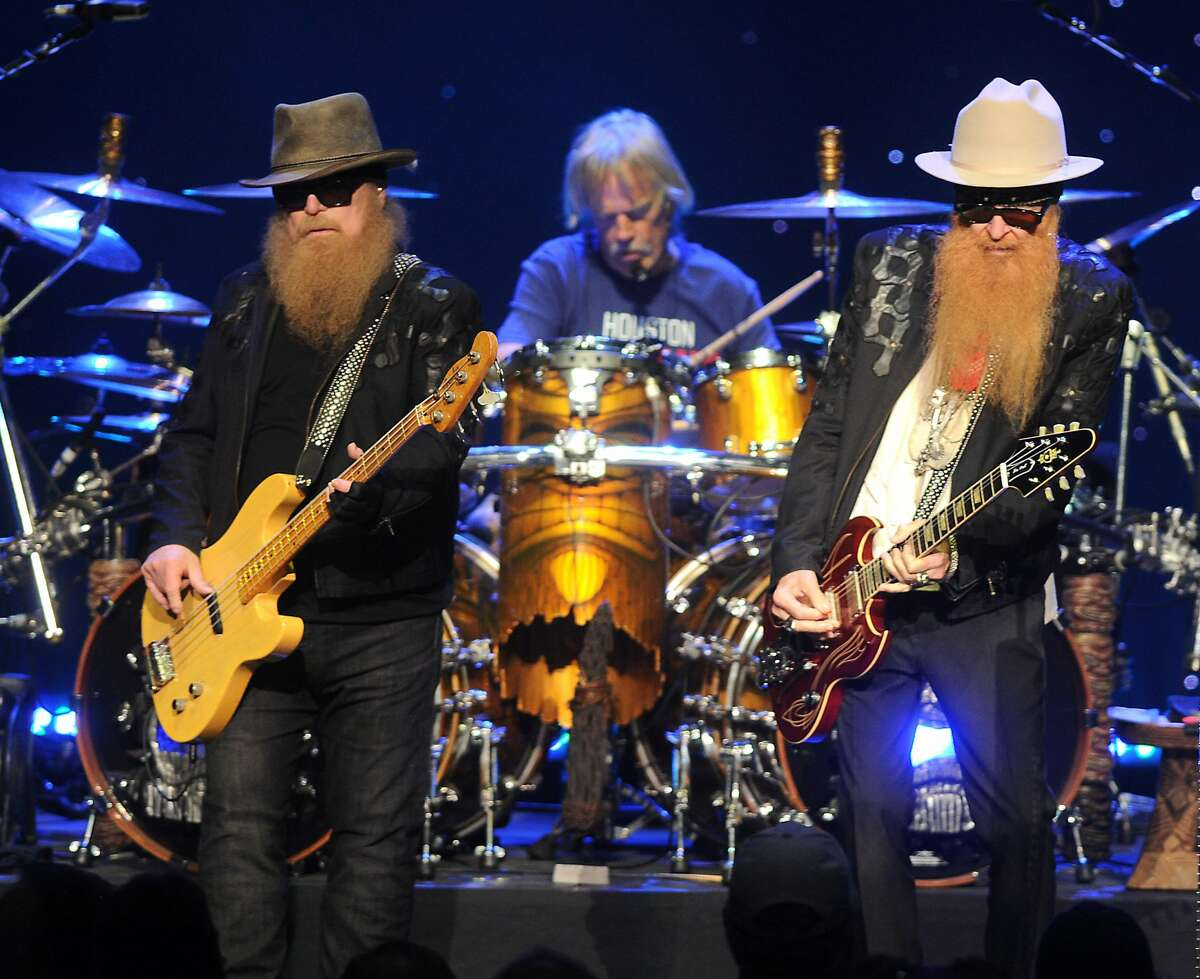 From left: Dusty Hill, Frank Beard and Billy Gibbons of ZZ Top perform during their Tonnage Tour at the Smart Financial Centre in Sugarland Sunday Sept. 10, 2017.(Dave Rossman Photo)