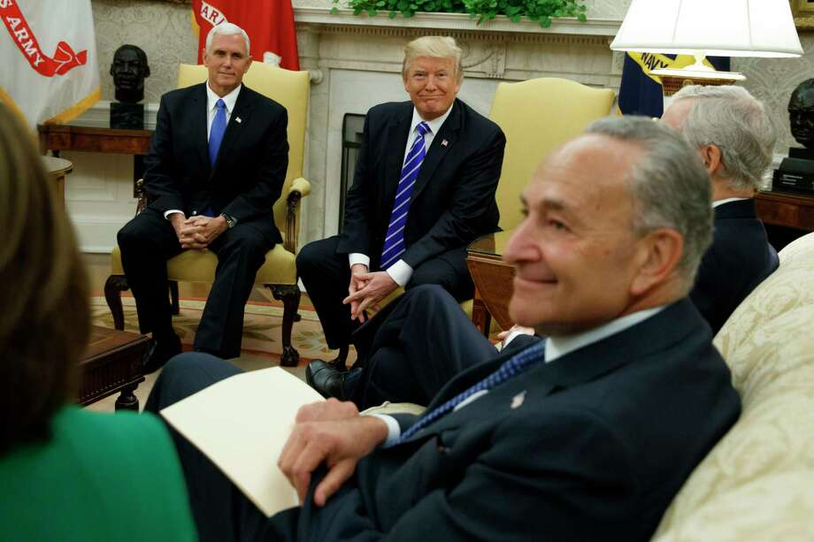 Vice President Mike Pence looks on with President Donald Trump during a meeting with Senate Minority Leader Chuck Schumer, D-N.Y., and other Congressional leaders in the Oval Office of the White House, Wednesday, Sept. 6, 2017, in Washington. (AP Photo/Evan Vucci) Photo: Evan Vucci, STF / Copyright 2017 The Associated Press. All rights reserved.