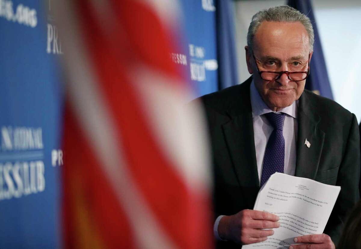 Senate Minority Leader Chuck Schumer of N.Y. walks back to his seat after giving opening remarks during a news conference at the National Press Club in Washington, Monday, Feb. 27, 2017. (AP Photo/Alex Brandon)