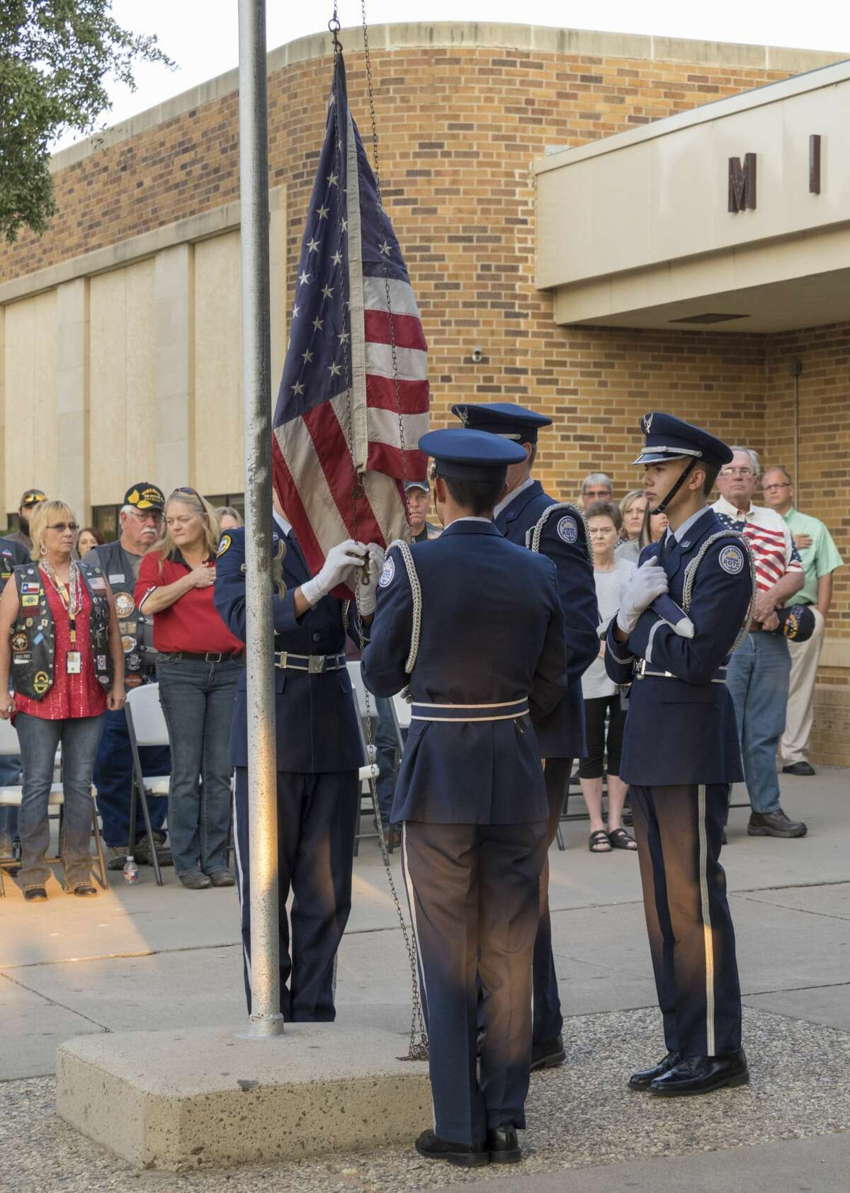 Members of Midland High JROTC raise the flag and then lower it to half mast 9/11/17 outside Midland High School at the 16th annual 9-11 Memorial. Tim Fischer/Reporter-Telegram