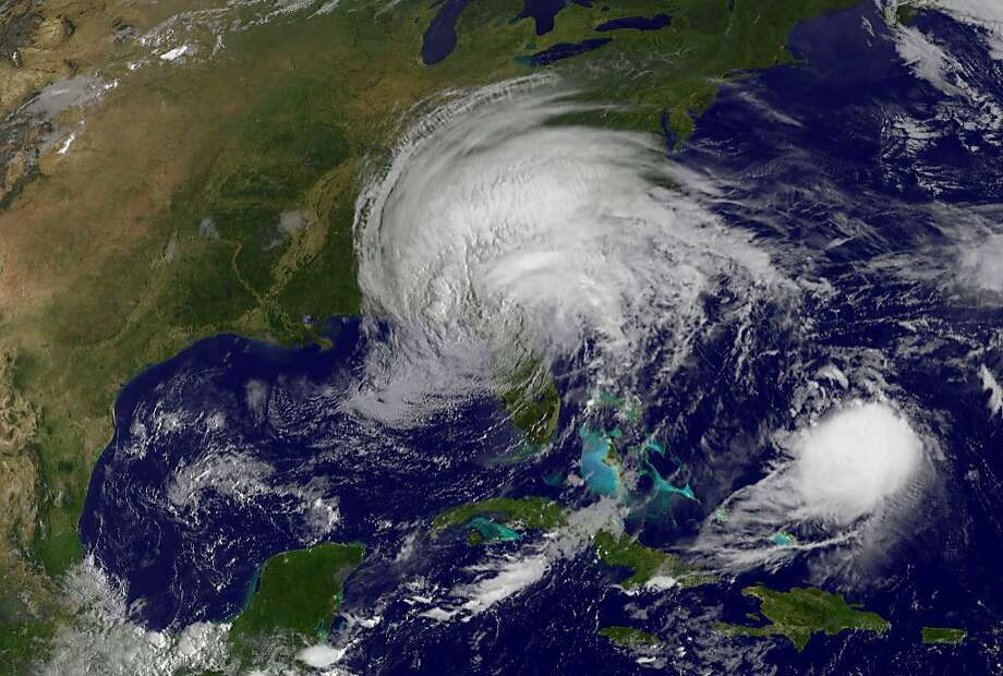 This image obtained from the NASA's GOES Project shows Tropical Storm Irma on September 11, 2017 and Hurricane Jose (lower R). At least 10 people were killed as Hurricane Irma ripped through Cuba over the weekend, the country's civil defense organization said Monday. Early reports of Irma's aftermath seemed to show that damage in Florida from the massive storm were not as bad as initially feared. Photo: HO, AFP/Getty Images