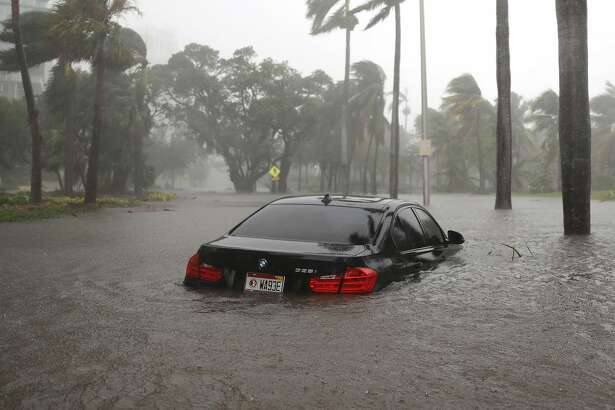 A car is seen in a flooded street as Hurricane Irma passes through on Sept. 10, 2017 in Miami, Florida. Hurricane Irma made landfall in the Florida Keys as a Category 4 storm on Sunday, lashing the state with 130 mph winds as it moves up the coast.