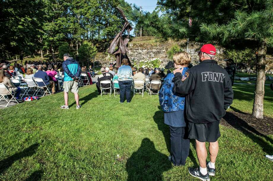 Members of the Saratoga Springs Police and Fire Departments and various civilians both public and private  assemble for the 9/11 Remembrance Ceremony in High Rock Parkon Monday, Sept. 11, 2017, in Saratoga Springs, N.Y.    (Skip        Dickstein/Times Union) Photo: SKIP DICKSTEIN, Albany Times Union / 40041506A