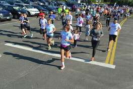 Around 250 people took part in the 3rd annual Kennedy  Center Autism SpectRUN at Jenning Beach Sunday morning, Sept. 10, 2017, in Fairfield, Conn.
