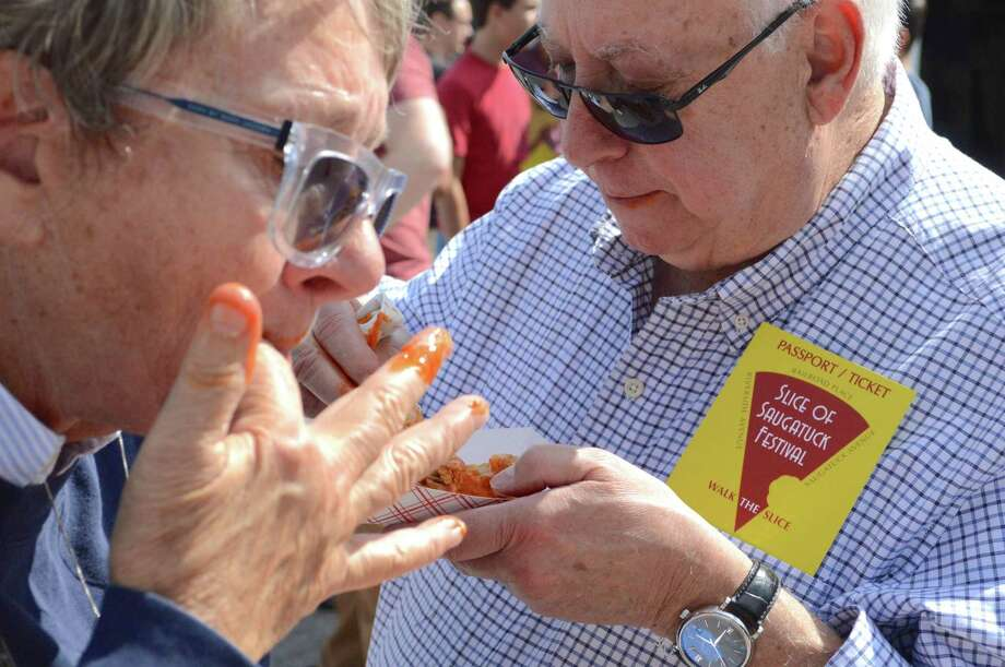 Bonnie Bohne and Andrew of Strauss of Saugatuck savor the sauce at the 6th annual Slice of Saugatuck Festival, Saturday, Sept. 9, 2017, in Westport, Conn. Photo: Jarret Liotta / For Hearst Connecticut Media / Westport News Freelance