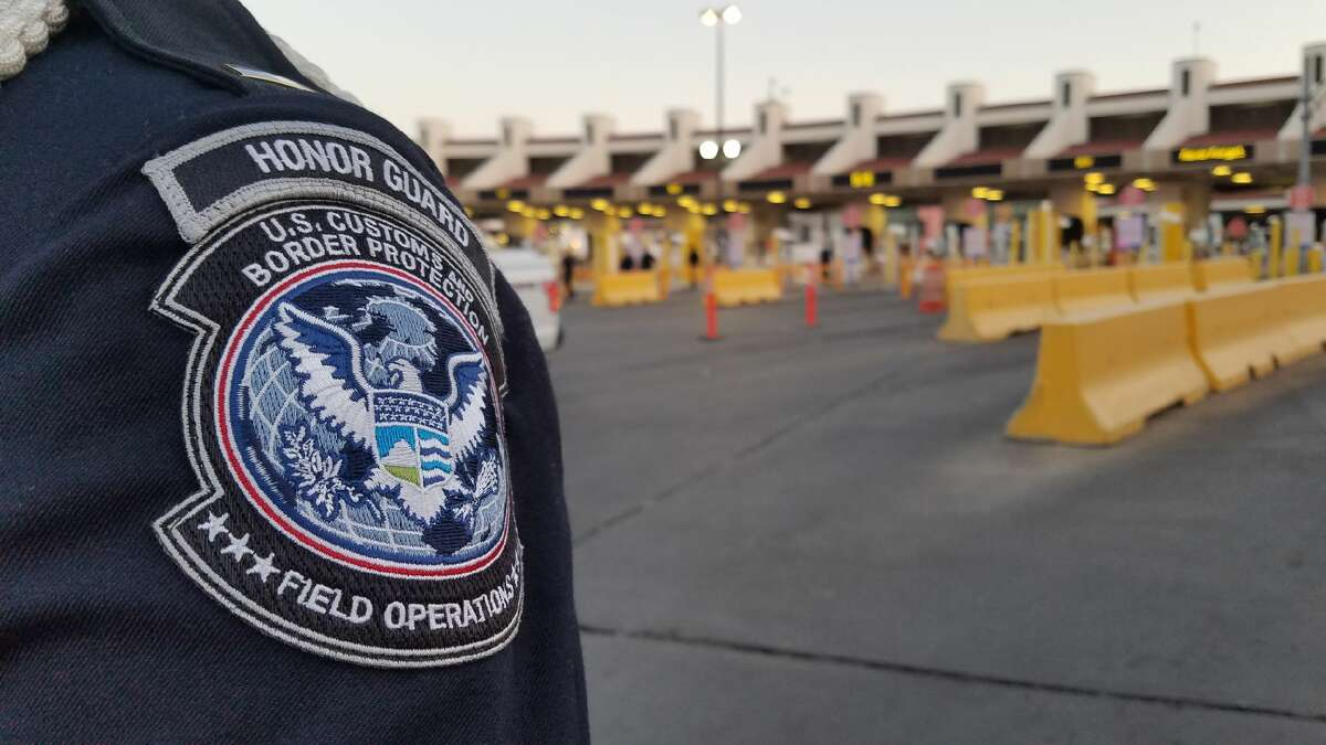 U.S. Customs and Border Protection halted vehicular traffic momentarily to allow authorities to pay homage to those who lost their lives in the terror attack.