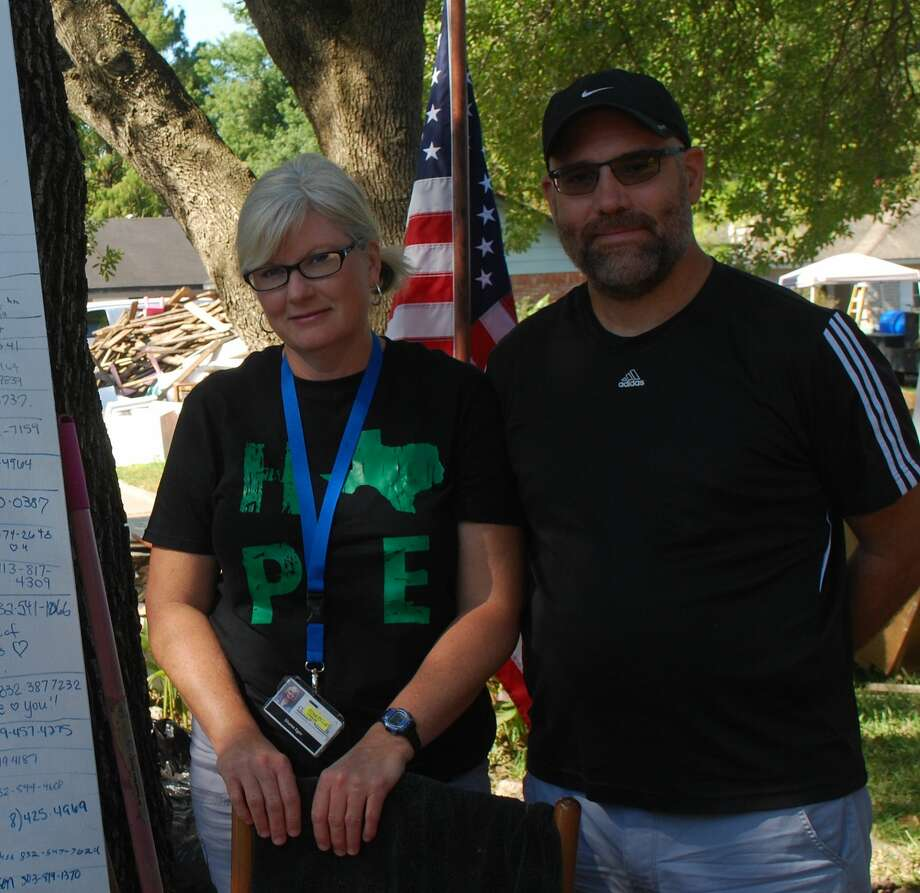 Doug and Shana Ekstrom outside their home in the Bayside Community, League City. Photo: Courtesy Photo