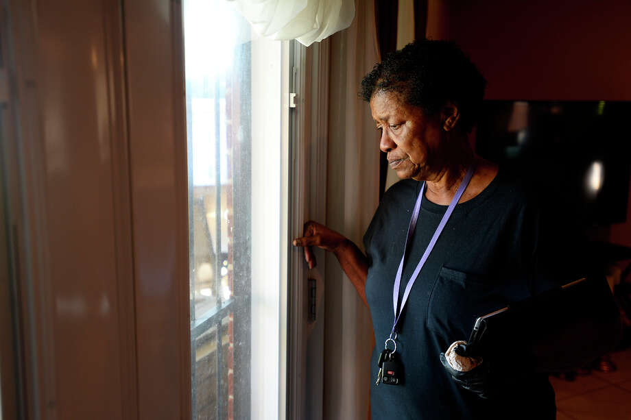 Shirley Payne looks out the window at her flood-damaged home in Port Arthur on Friday. Payne is staying with a friend but doesn't know where she'll go for long term housing while her house is fixed.  Photo taken Friday 9/8/17 Ryan Pelham/The Enterprise Photo: Ryan Pelham / ©2017 The Beaumont Enterprise/Ryan Pelham
