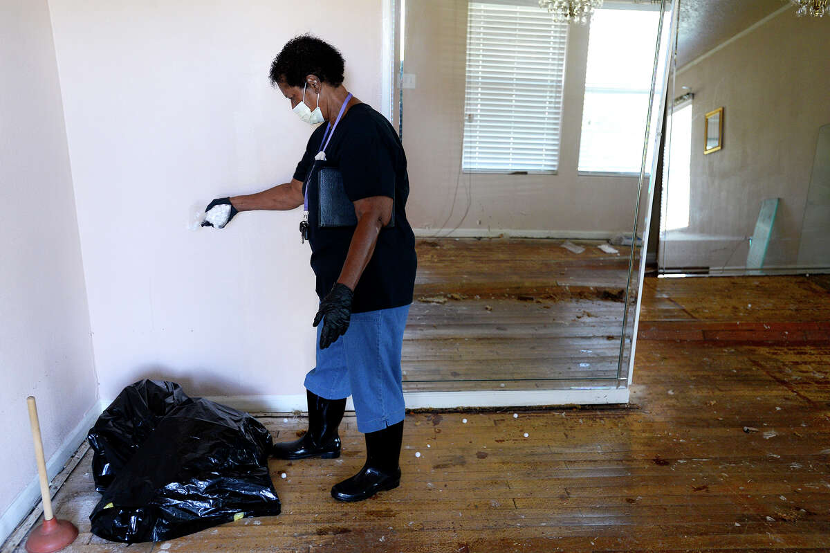 Click through to see the Top 20 ZIP codes for FEMA assistance after Hurricane Harvey. Shirley Payne spreads moth balls around the living room of her home in Port Arthur on Friday. Payne can't find a room at a FEMA-approved hotel to stay in after her house was damaged by flooding. Photo taken Friday 9/8/17 Ryan Pelham/The Enterprise