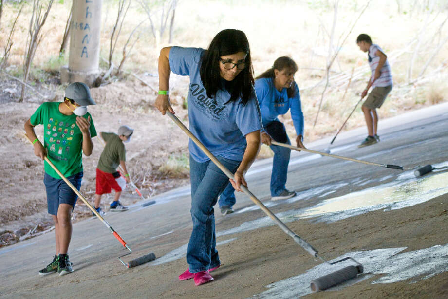 Volunteers from the Laredo North Border Patrol Explorers post 1987 are seen assisting with landscaping along the Chacon Creek as part of a clean-up effort by the City of Laredo on Saturday morning. The clean-up covered the length between the M.E. Benavides Chacon Creek trails onto the James and M.L. Haynes Recreation Center. Photo: Francisco Vera/Laredo Morning Times