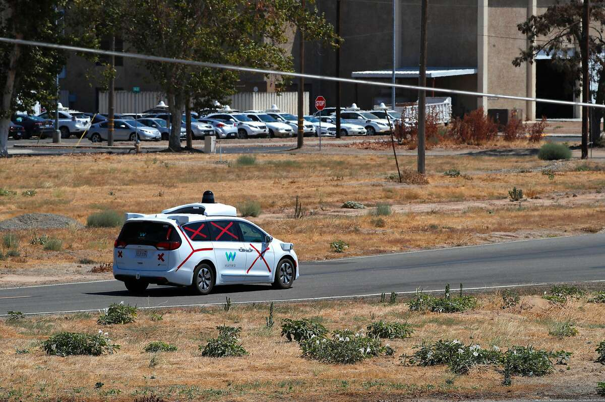 FILE-- A Waymo self-driving minivan, at the company's test facility in Merced County. A Waymo minivan on a test drive in Palo Alto was involved in a minor traffic accident in late August, with no injuries, according to a report the company filed with the state.