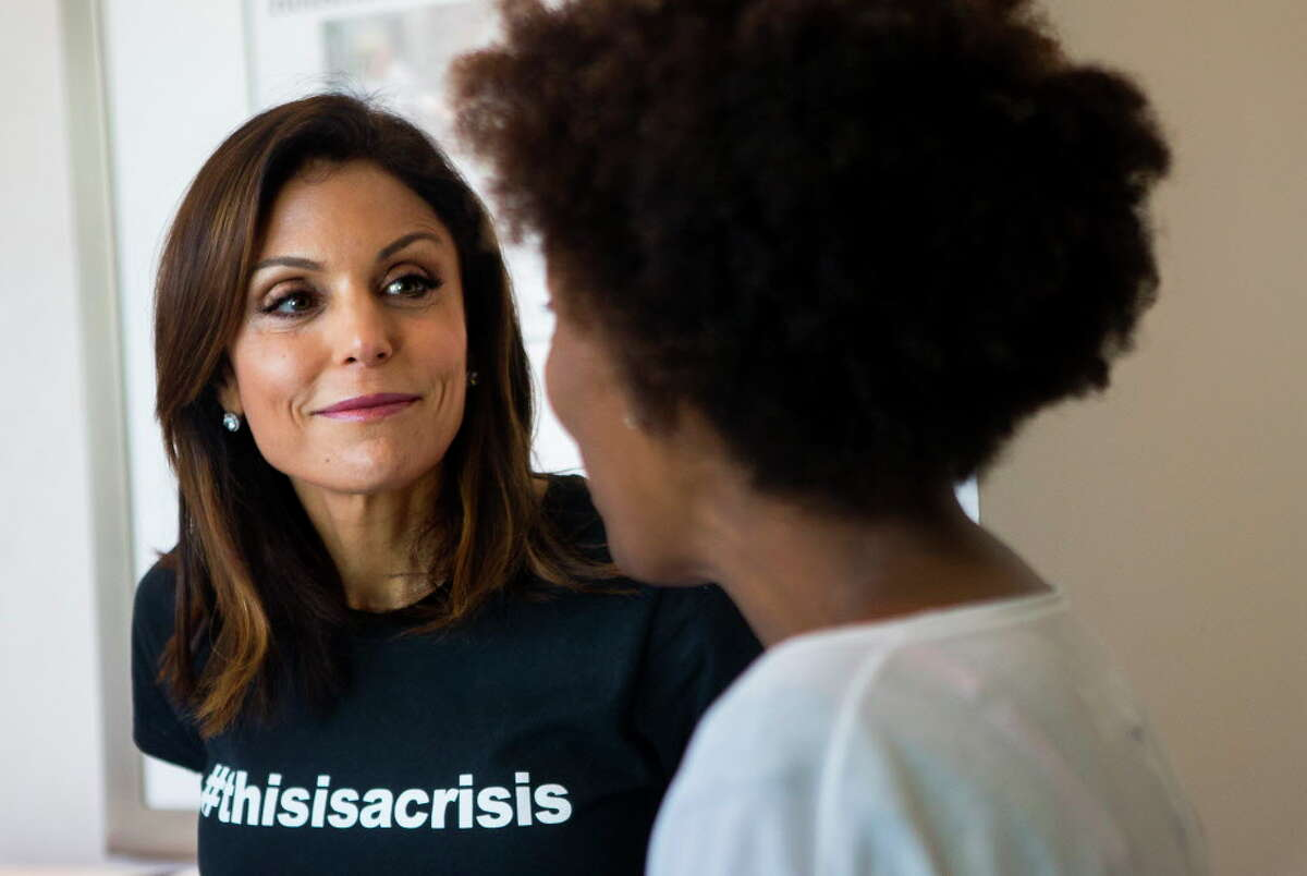 """""""Real Housewives of New York"""" reality TV star Bethenny Frankel chats with Dress For Success Houston clients during a special Harvey relief drive on Saturday, Sept. 8, 2017, in Houston."""
