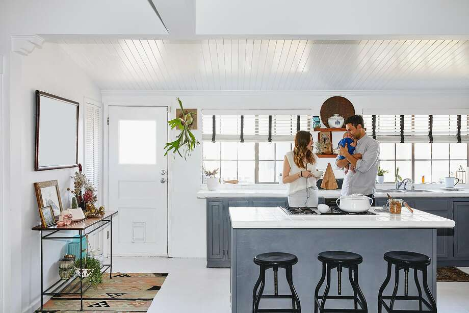Since baby Rye joined the family in June, Kelly Lack and Jon Solorzano's breakfast rituals are now a stand-up affair in the kitchen, a Scandinavian-inspired space that is airier and more modern than the rest of the house. Photo: Aurbrie Pick, Special To The Chronicle