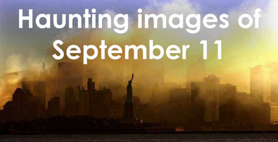 Haunting Images: The terror attacks of 9/11 The Statue of Liberty stands before the smoke rising from Ground Zero after the September 11, 2001 terror attacks. Photo: Dan Loh, Associated Press