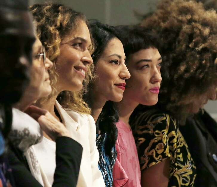Feminist Gloria Steinem, second from left, Huma Abedin, second from right, wait for the start of the Prabal Gurung Spring/Summer 2018 fashion show during Fashion Week, Sunday, Sept. 10, 2017, in New York. (AP Photo/Kathy Willens)