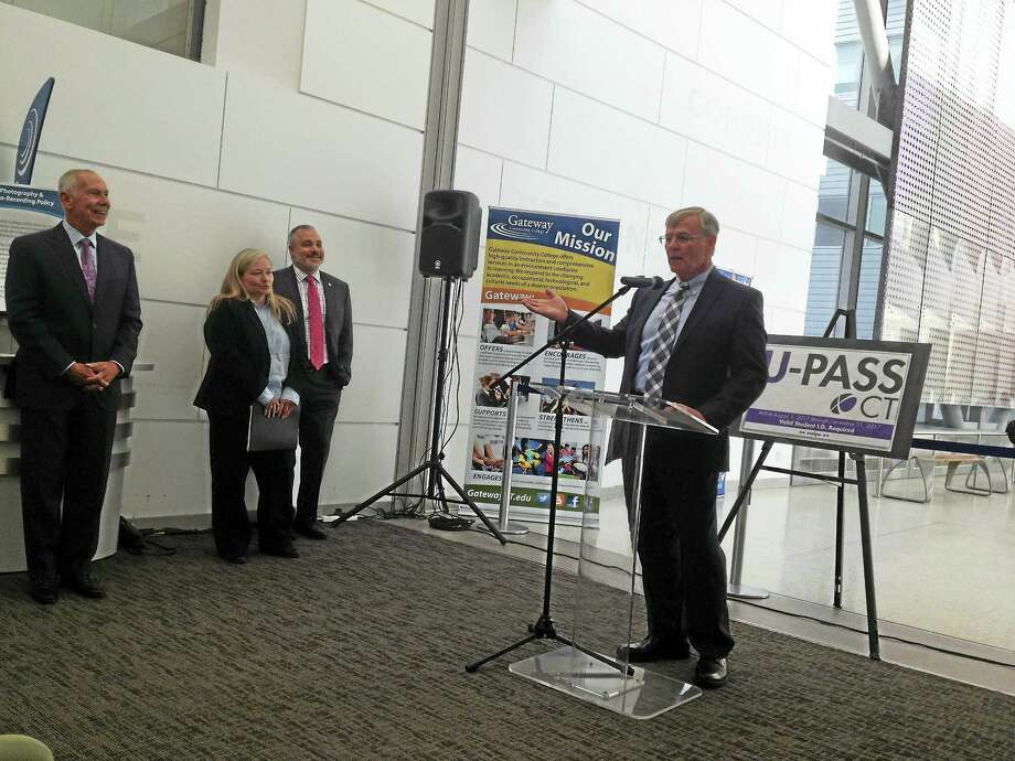 Connecticut Department of Transportation Commissioner James Redeker speaks about U-Pass CT at Gateway Community College. At left are Connecticut State Colleges and Universities system President Mark Ojakian, UConn Transportation Planner Tanya Husick and Southern Connecticut State University President Joe Bertolino. (Brian Zahn/Hearst Connecticut Media)