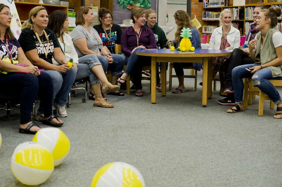 Siebert Elementary staff gather for a meeting after school before Siebert Elementary teacher Amy Burks is awarded four Caribbean vacations after being nominated by fellow Siebert teacher Megan Storm for a contest hosted by CheapCaribbean.com in celebration of National Teacher Appreciation Day on Friday, September 8, 2017 at Siebert Elementary. (Katy Kildee/kkildee@mdn.net) Photo: (Katy Kildee/kkildee@mdn.net)