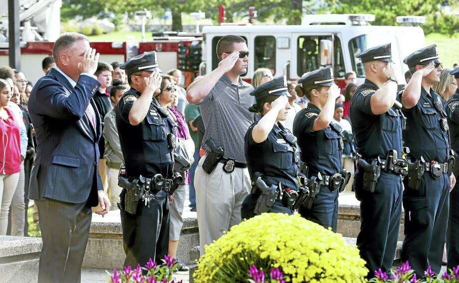 Milford police take part in a 9/11 ceremony in front of Platt Technical High School in Milford on Monday. Photo: Arnold Gold / Hearst Connecticut Media / New Haven Register