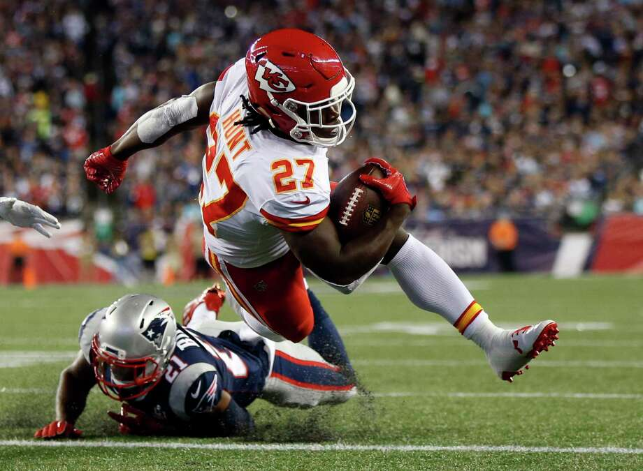 Kansas City Chiefs running back Kareem Hunt (27) scores a touchdown past New England Patriots cornerback Malcolm Butler (21) during the first half of an NFL football game, Thursday, Sept. 7, 2017, in Foxborough, Mass. (AP Photo/Michael Dwyer) Photo: Michael Dwyer, STF / Internal