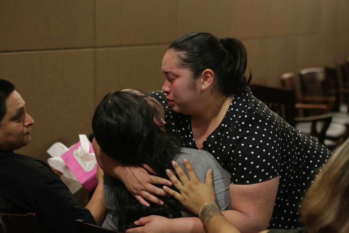 Clarissa Balleza (right) hugs her sister Carlotta Balleza, mother of Josiah Williams, following the guilty verdict Monday. At left is Laura Huereca, Carlotta Balleza's partner.