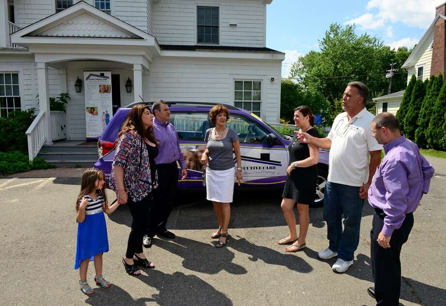 Executive Care, a home health care service based in New Jersey, Main Street in Stratford, Conn. Owner Michael Savoie, second from right, speaks to some of those involved in the franchise. Photo: Christian Abraham / File Photo / Connecticut Post