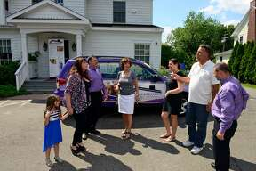 Executive Care, a home health care service based in New Jersey, Main Street in Stratford, Conn. Owner Michael Savoie, second from right, speaks to some of those involved in the franchise.
