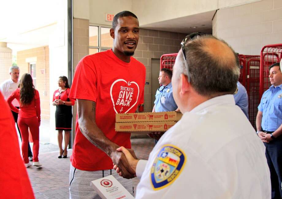 Trevor Ariza and the Rockets delivered pizza to Houston area fire and police stations. (Photo by Houston Rockets)