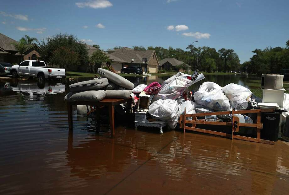 Damaged furniture and personal belongings sit in front of a flooded home on Sept. 7 in Richwood, Texas.  (Photo by Justin Sullivan/Getty Images) Photo: Justin Sullivan, Staff / 2017 Getty Images