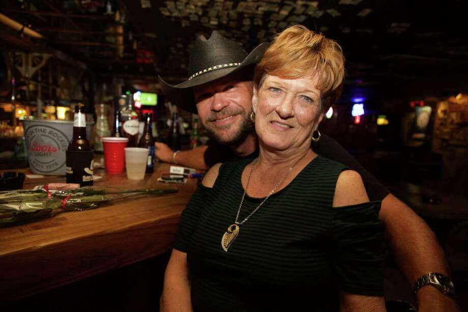 Larry Stelle and Peggy Morin hang out at The Hangin Tree Saloon. Photo: Xelina Flores /For The Express-News