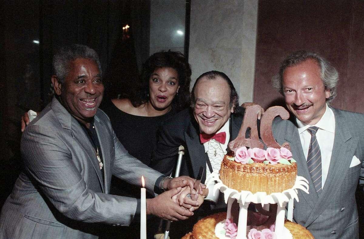 Dizzy Gillespie, left, Lizette Cobb, Arnett Cobb and Wolf Hengst at Arnett Cobb's birthday party, Aug. 10, 1987.