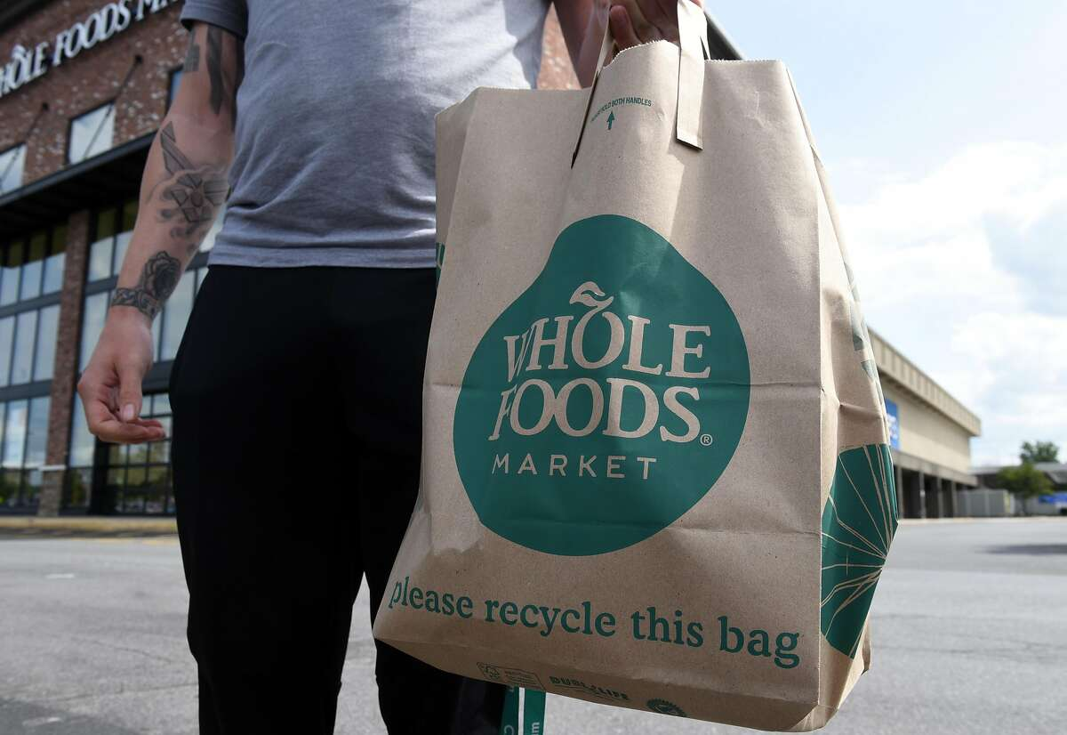 Bag filled with groceries from the Whole Foods market at Colonie Center on Monday, Aug. 28, 2017, in Colonie, N.Y. The company announced last week that the credit card information of customers may have been exposed to hackers. Click through the gallery to see how the store's prices have changed over the past two years.