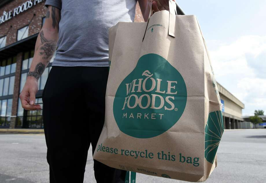 Bag filled with groceries from the Whole Foods market at Colonie Center on Monday, Aug. 28, 2017, in Colonie, N.Y. Amazon cut prices at the upscale supermarket on Monday after its buyout of the natural-foods chain was finalized. (Will Waldron/Times Union) Photo: Will Waldron, Albany Times Union