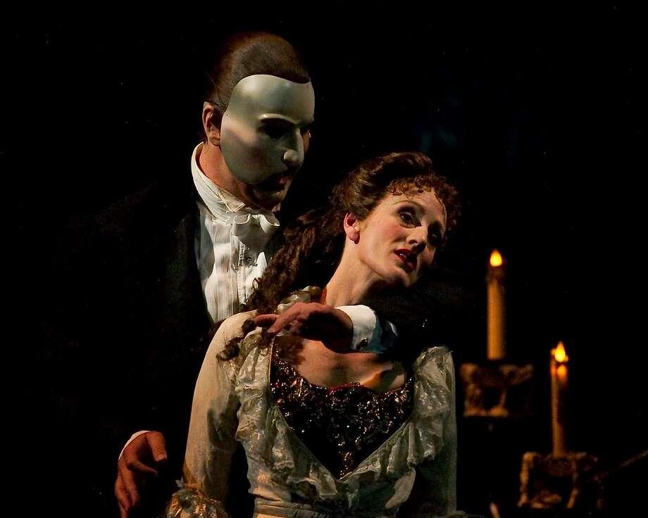 "Lisa Vroman as Christine in ""Phantom of the Opera,"" with Brad Little as the Phantom. Photo: JOHN O'HARA, SFC"