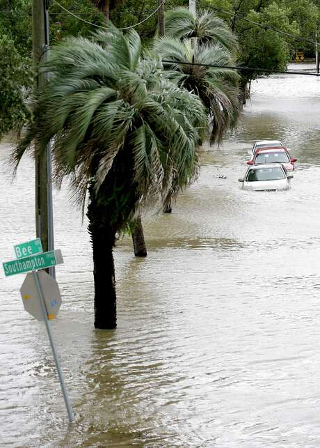 Cars with water over the doors are parked in a downtown neighborhood after Hurricane Irma brought floodwaters to Jacksonville, Fla. Monday.  (AP Photo/John Raoux) Photo: John Raoux, STF / Copyright 2017 The Associated Press. All rights reserved.