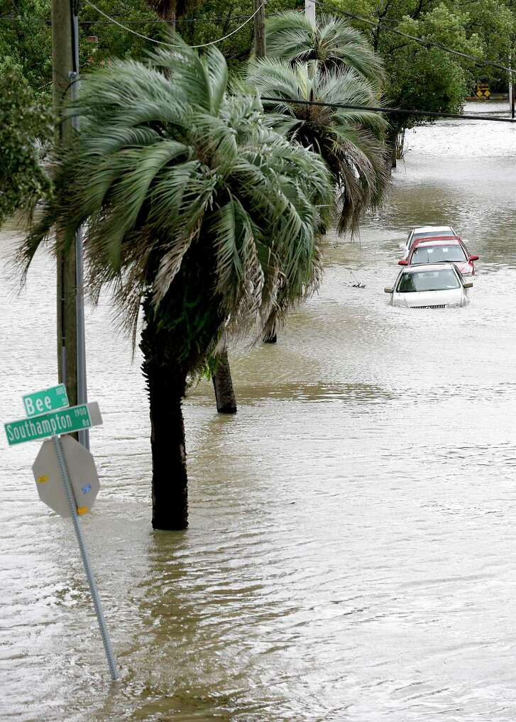 Cars with water over the doors are parked in a downtown neighborhood after Hurricane Irma brought floodwaters to Jacksonville, Fla. Monday.  (AP Photo/John Raoux)