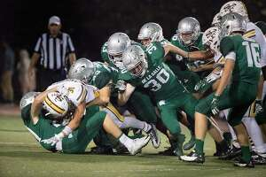 De La Salle Jacob Huckelberry (30) and other tackle Saint Francis Lucas Andrighetto (31) in the 2nd half at De La Salle High School on Friday, Sept. 8, 2017 in Stockton, CA.