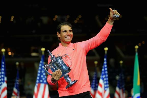NEW YORK, NY - SEPTEMBER 10:  Rafael Nadal of Spain poses with the championship trophy during the trophy ceremony after defeating Kevin Anderson of South Africa during their Men's Singles finals match on Day Fourteen during the 2017 US Open at the USTA Billie Jean King National Tennis Center on September 10, 2017 in the Queens borough of New York City.  (Photo by Chris Trotman/Getty Images for USTA)