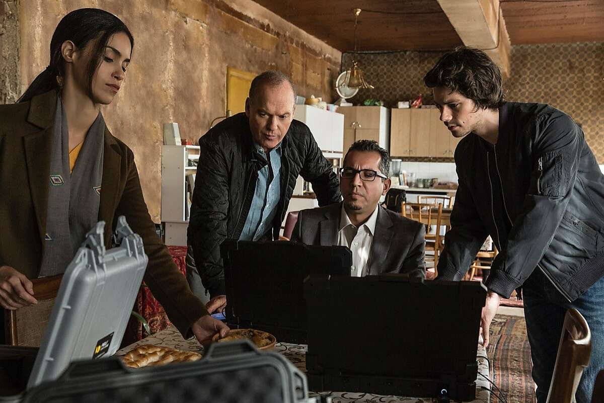 """This image released by Lionsgate shows, from left, Shiva Negar, Michael Keaton, Neg Adamson and Dylan O�Brien in a scene from, """"American Assassin."""" (Christian Black/Lionsgate via AP)"""